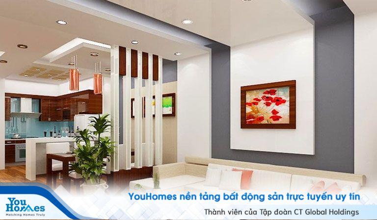 Phòng khách liền bếp được ngăn cách với vách ngăn sẽ giúp người sử dụng bếp thoải mái hơn.