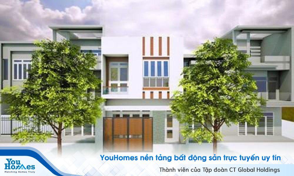 Cách phối màu sơn giữa trắng và nâu giúp căn nhà 2 tầng hiện đại trở nên ấm áp.