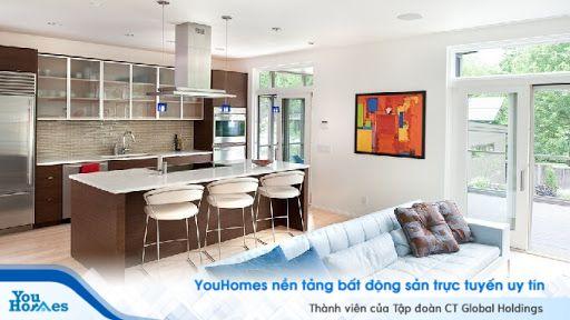 Thiết kế phòng khách liền bếp đậm chất hiện đại với phòng quầy bar cực kỳ hợp lý.