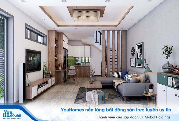 Chất liệu gỗ được ứng dụng rất nhiều cho các mẫu phòng khách liền bếp.