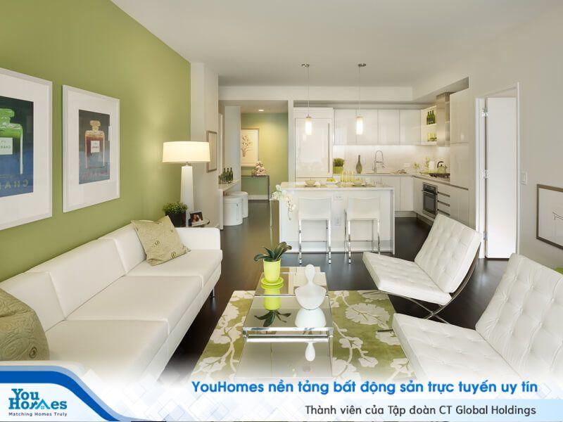 Xanh lá cây phối trắng giúp phòng khách liền bếp mềm mại và có sức sống.
