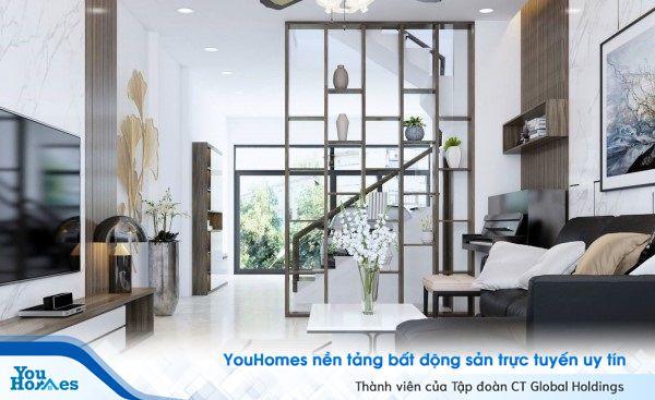 Mẫu vách ngăn giữa phòng khách và cầu thang dạng kệ trang trí.