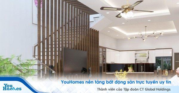 Mẫu vách ngăn phòng khách với cầu thang kết hợp với Tivi.