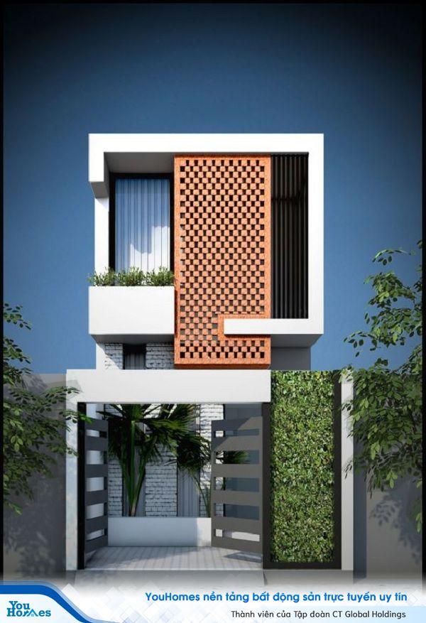 Bức tường gạch màu đỏ tạo điểm nhấn nổi bật cho ngôi nhà vừa giúp thông gió, che nắng và lấy được nhiều ánh sáng.