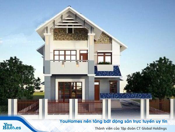 Ngôi nhà 2 tầng mái thái màu trắng nhẹ nhàng.